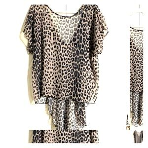 High low sheer blouse in grey leopard.